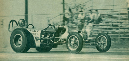 """Mickey Brown"" driving an old dragster - CC BY SA by ""Insomnia Cured Here"" on Flickr"